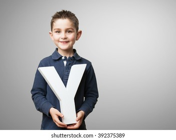 little kid holding the y letter
