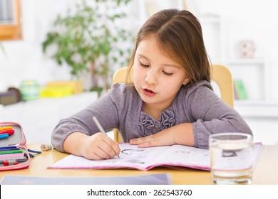 A kid doing homework