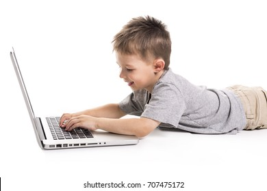 little kid with laptop lay on the ground