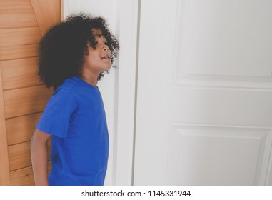 Little kid looking at the door waiting for parents