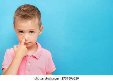 Little kid picks up in his nose. bad habits concept