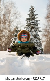 Little kid play with snow