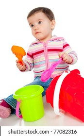little kid playing with colorful toys on a white background