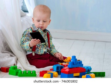 A little kid is playing with toys