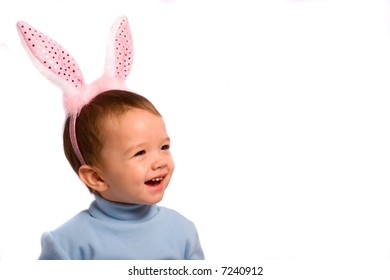 Little kid in rose rabbit's horn