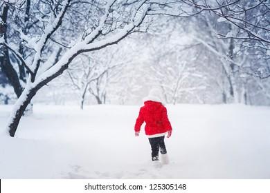 Little kid  running on snow