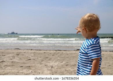 Little kid and a sea with boat