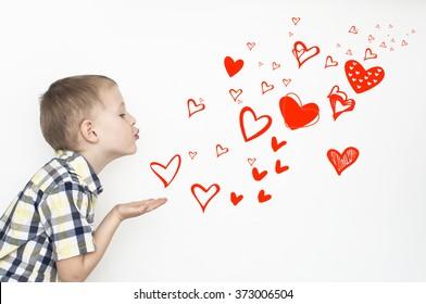 Little kid is sending heart shaped kisses