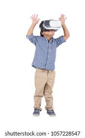 Little kid standing, wearing the VR glasses raising his both hands frightened, isolated on a white background.