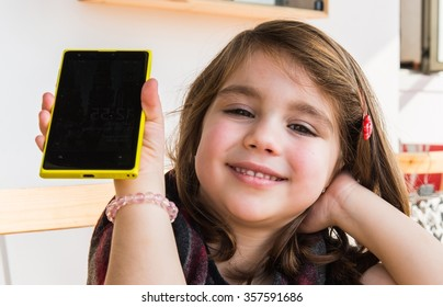 Little kid talking to mobile