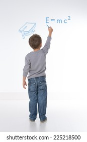 little kid tries to solve equation on the wall