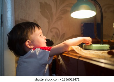 little kid turning off the light