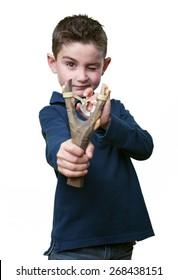 little kid using a slingshot