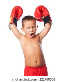 A little kid wearing a boxer gloves