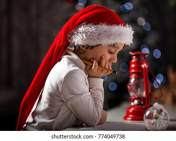 Little kid writes a letter to Santa Claus