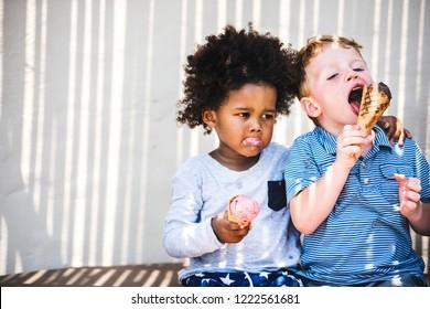 Little kids eating yummy ice cream