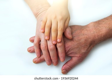 Little kids grandson hands on old hands of grandparents. Concept assistance, patronage and generation. National Senior Citizens Day. World Humanitarian Day