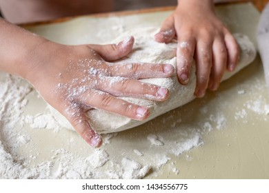 little kids hands working with yeast pastry