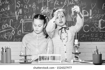 Little kids learning chemistry. Chemistry equipment. students do biology experiments with microscope in lab. Happy children. Chemistry lesson. Chemistry education. Our goal is to find the cure.