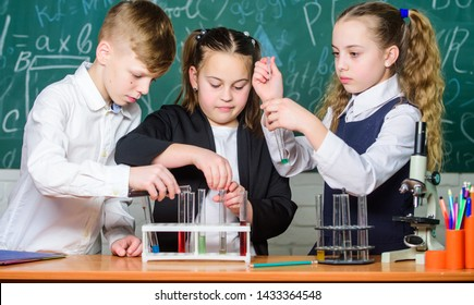 Little kids learning chemistry in school lab. students doing biology experiments with microscope. childrens day. Chemistry. Back to school. Little children at school lesson. Confident pharmacist.