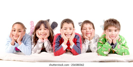 little kids on their pajamas in bed isolated in white