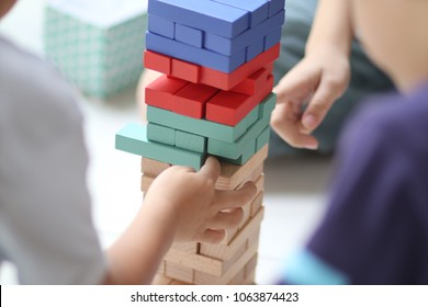 little kids play the wooden block
