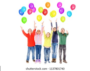 little kids playing with balloons isolated in white
