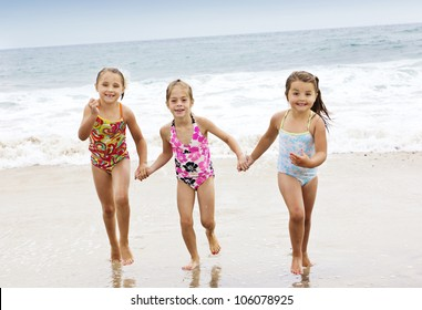 Little kids Playing at the Beach