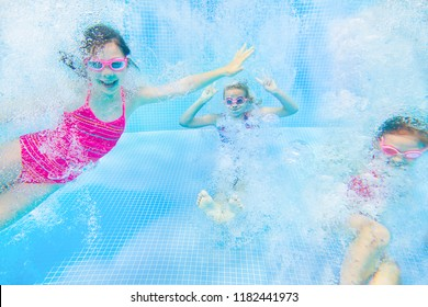 little kids swimming  in pool,  underwater photo,
