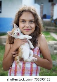 little kitten with little girl