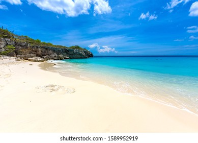 Little Knip beach - paradise white sand Beach with blue sky and crystal clear blue water in Curacao, Netherlands Antilles, a Caribbean tropical Island