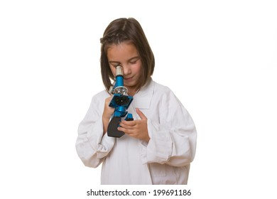 Little laboratory girl in over sized medical uniform. Isolated on white background.