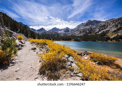Little Lakes Valley hiking trail on a sunny fall day, following the shoreline of Long Lake in the Eastern Sierras; John Muir Wilderness; California