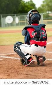 Little league baseball boy from behind.