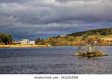 Little Loch Shin and Lairg dam, with the Broon's Hoose on the island