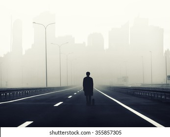 little man on the big road to the big city ,metaphorical background ,lonely and small man  on big highway to the city,looking for jobb,work seeking,