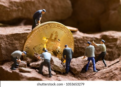 little miner is digging for bitcoin  . conceptual image for bitcoin mining and discovery crypto currency. , financial concept