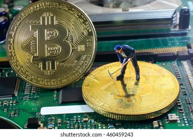 A little miner is digging for bitcoin with graphic card. 