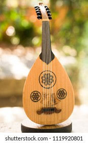Little model of a Classic stringed musical instrument Ud