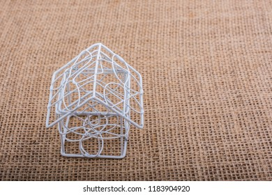 Little model house   placed on a brown background