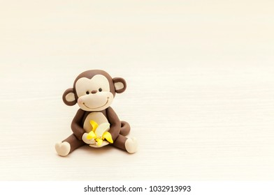 little monkey toy sitting with a banana, marzipan decorations