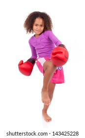 Little muay thai boxing girl using her knee,isolated on white background