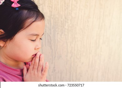 little multiethnic girl praying, kid, child pray concept,World Day of Prayer,international day of prayer