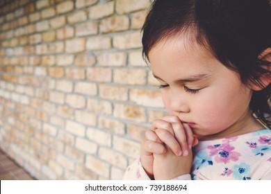 little multiethnic girl praying, kid, child pray concept, child, kid prayer, World Day of Prayer,international day of prayer