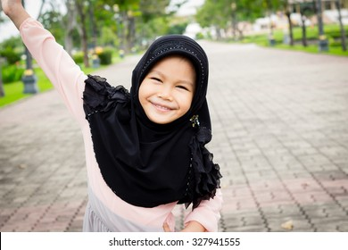 little muslim girl playing outdoor