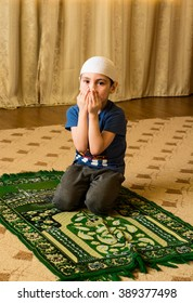 Little Muslim worshiper at the mosque .