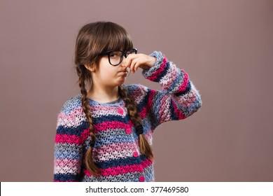 Little nerdy girl doesn't like how something smells..Aww something smells so bad!