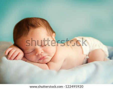 Little newborn baby boy 14 days, sleeps