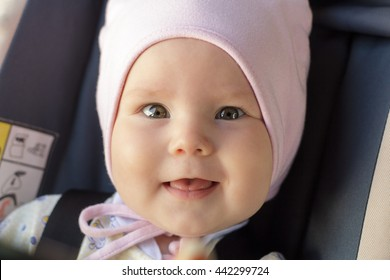 little newborn baby girl rests in the car seat