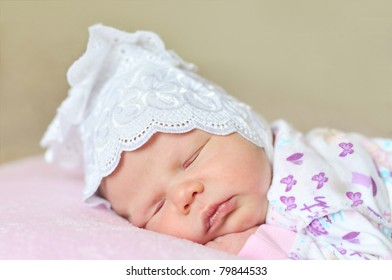 little newborn girl dreaming at home